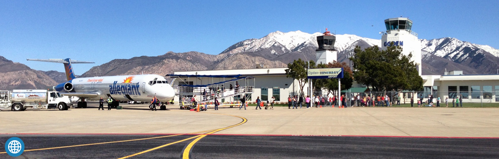 Outside of the Ogden-Hinckley Airport with people walking out of an airplane