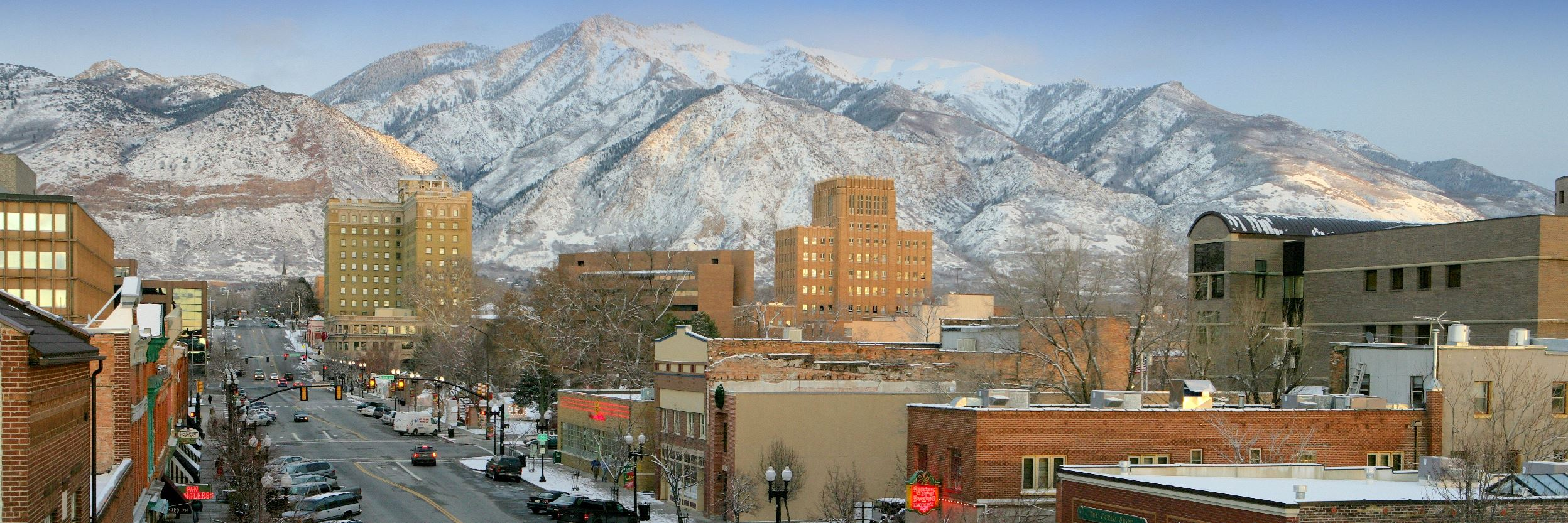 A street view of Ogden City with mountains in the background
