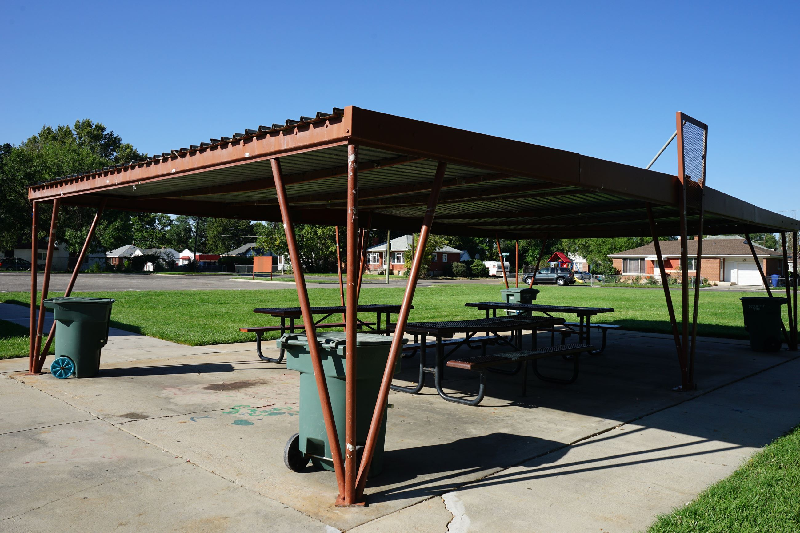Three tables covered by a metal structure