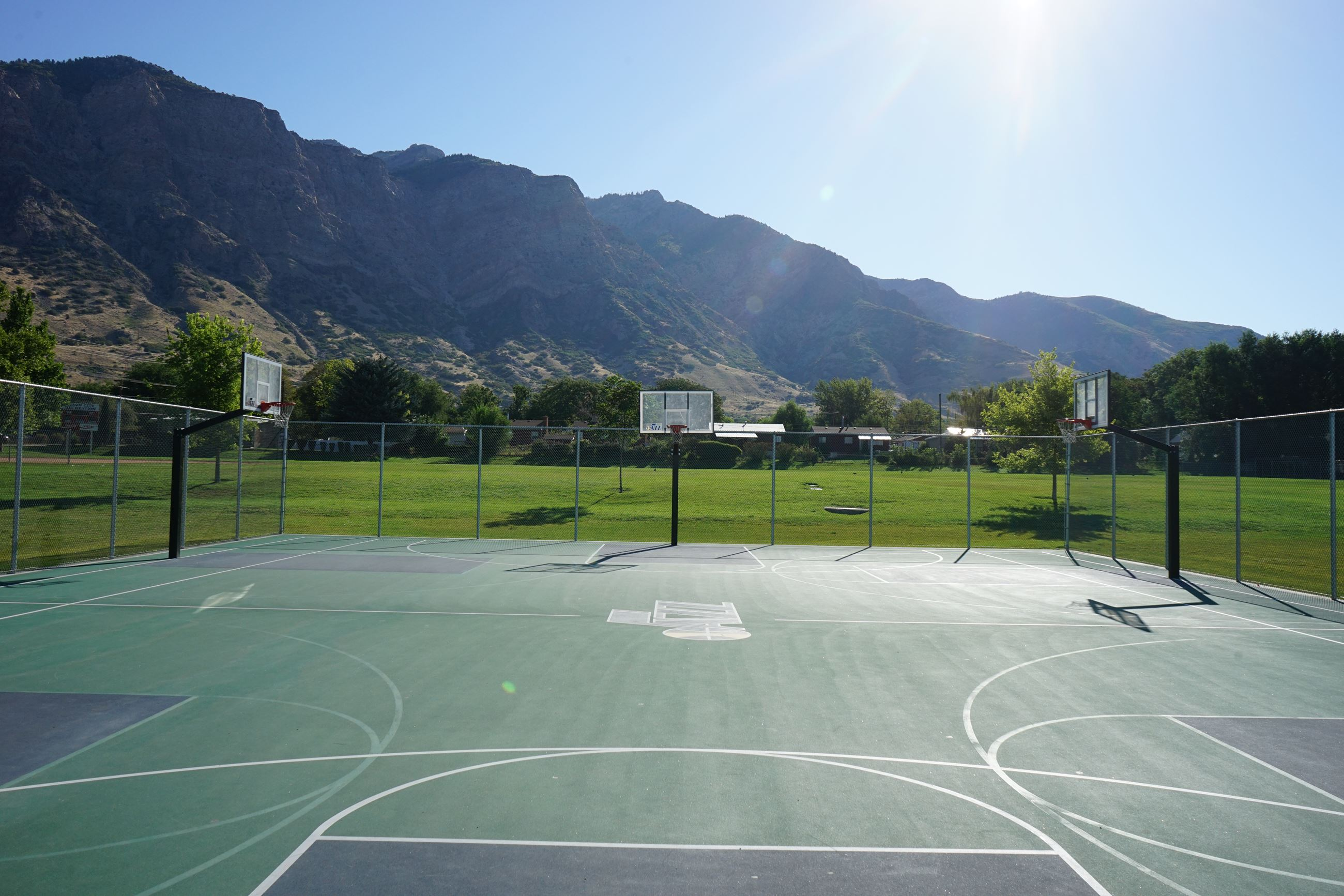 A basketball court with mountains in the background